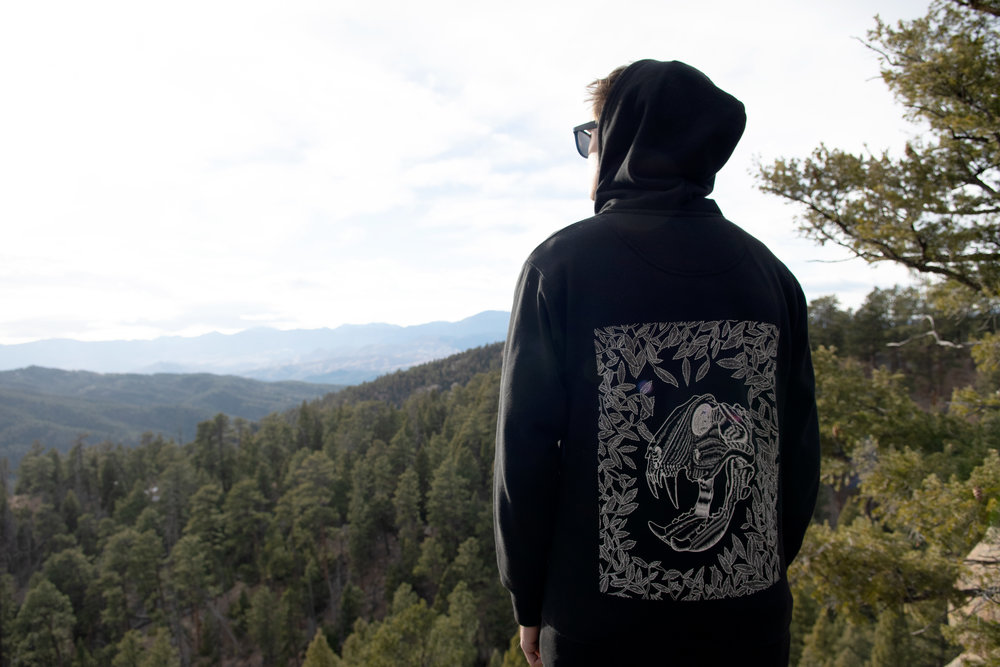 This is me! Looking out over some mountains in Sedalio, CO. The sweatshirt graphic is one of my own illustrations.