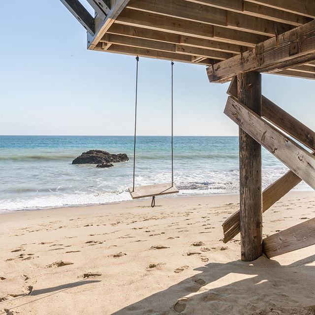 What better place to hang this weekend? Carbon Beach by Ross Brothers #ocean #view #swing
