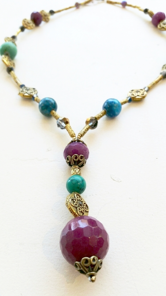 CRYSTAL, BRASS AND JADE NECKLACE