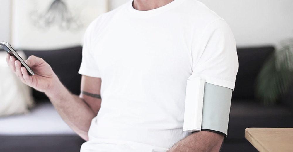 QardioArm taking blood pressure with a smartphone
