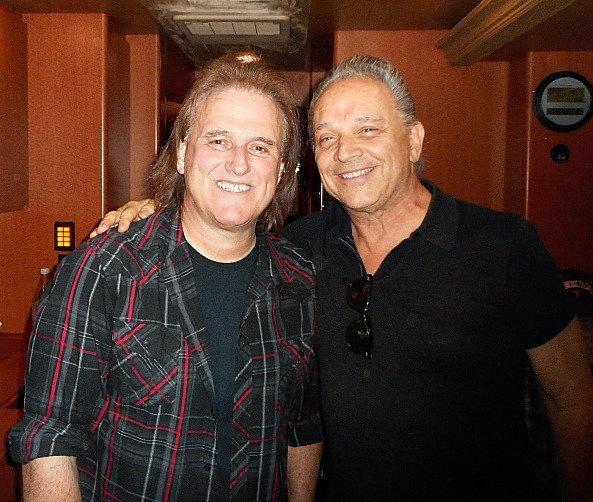 Rocky with Jimmie Vaughan at the Wildflower Music Festival talking out their Oak Cliff days.