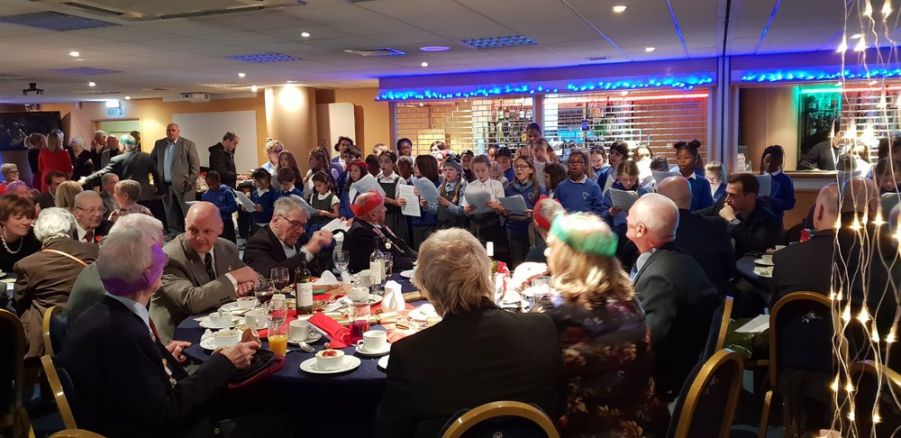 The choir visited Millwall to entertain the veterans and Chelsea pensioners with Christmas Carols at their annual Christmas lunch. They performed superbly, spread much good cheer and had a tour of the Millwall facilities. They also heard a first hand account of the D- day landings from Fred, who served in the Parachute Regiment in WWII.