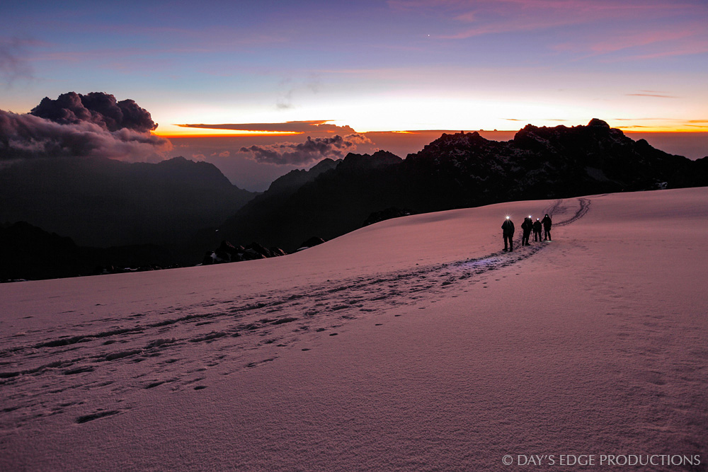 A climbing team crosses the Stanley Plateau glacier on Mount Stanley, Rwenzori Mountains National Park, Uganda.