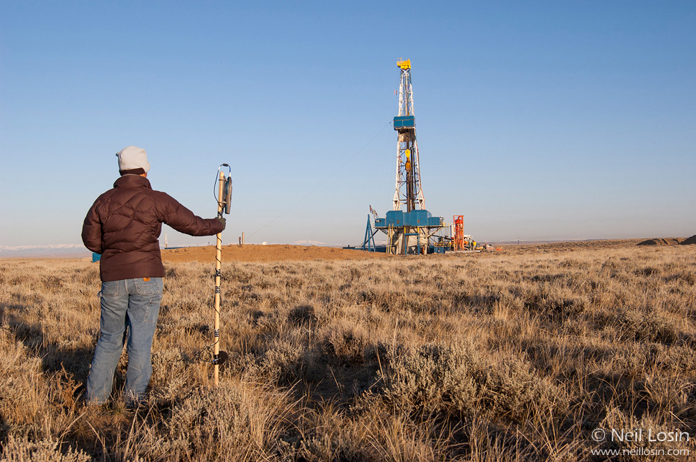 A researcher measures sound pressure level (SPL) of the noise emitted by a natural gas drilling rig in the Pinedale Anticline gas field near Pinedale, Wyoming, USA. Natural gas drilling, and particularly the noise associated with drilling, has been implicated in population declines of the Greater Sage-Grouse, a species of conservation concern in the American West.