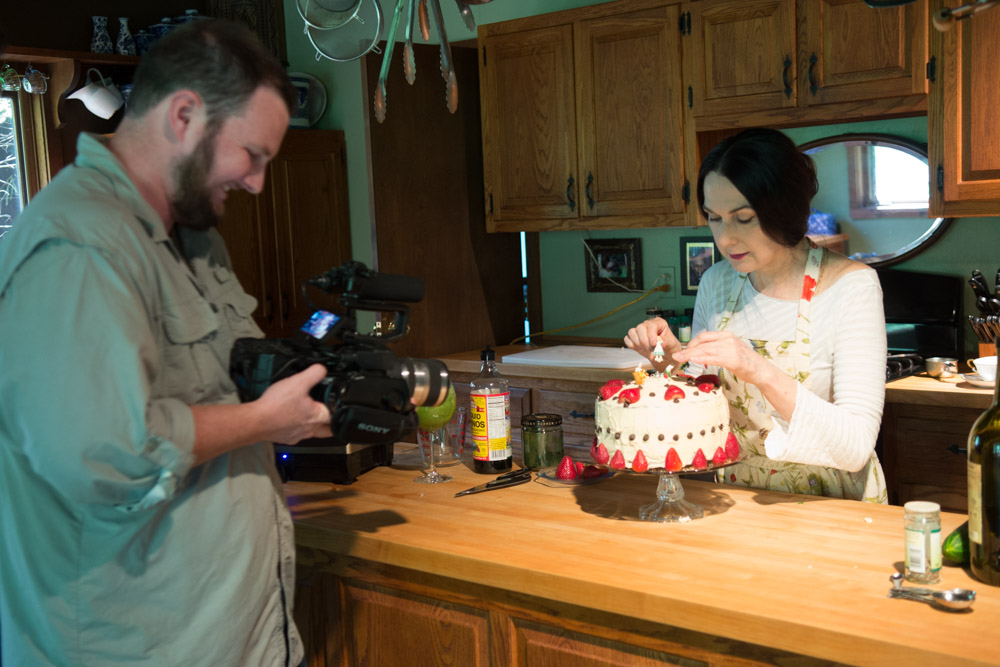 Sharon preparing cake for the video shoot for  Simple Recipes for Joy  PR trailer. Photo by Derek Pashupa Goodwin.
