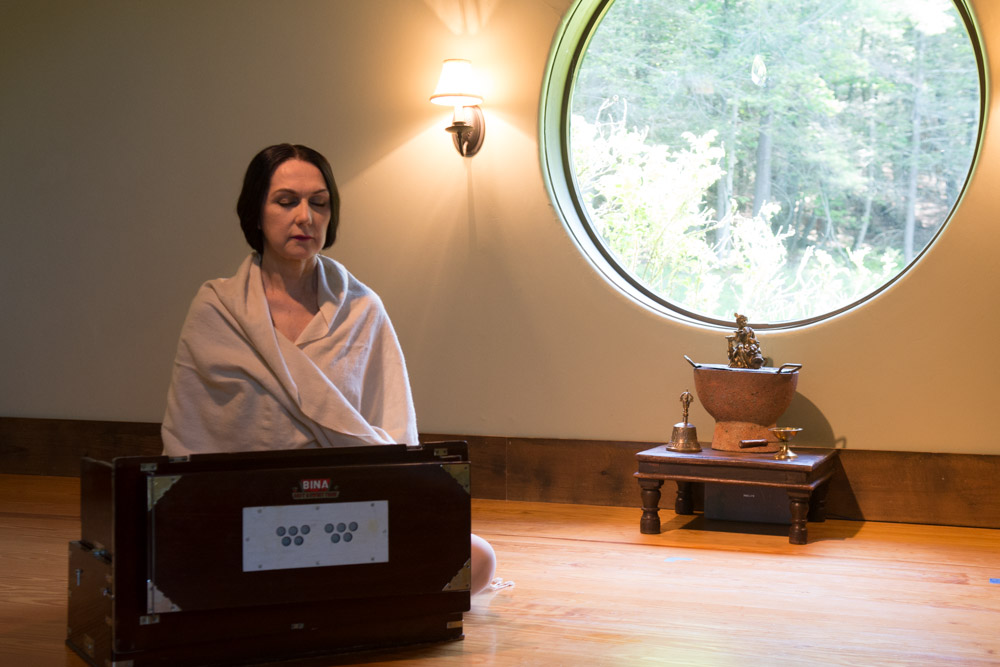 Sharon meditating in the Wild Woodstock Yoga Shala #2. Photo by Derek Pashupa Goodwin.