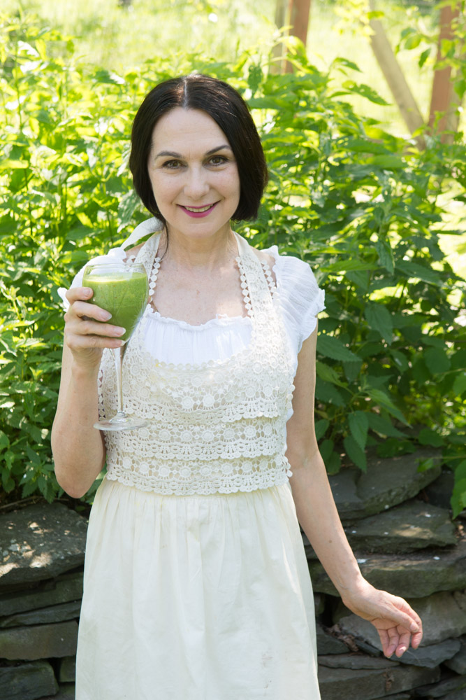 Sharon with a  Love Smoothie  and a backdrop of wild nettles at the Wild Woodstock Forest Sanctuary #6. Photo by Derek Pashupa Goodwin.