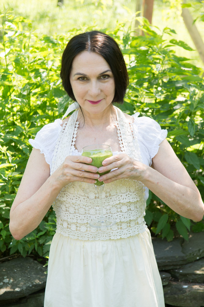 Sharon with a  Love Smoothie  and a backdrop of wild nettles at the Wild Woodstock Forest Sanctuary #9. Photo by Derek Pashupa Goodwin.