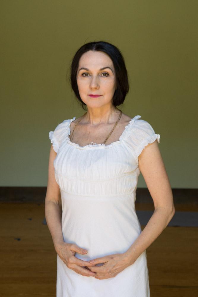 Sharon white dress studio portrait #1. Photo by Derek Pashupa Goodwin.