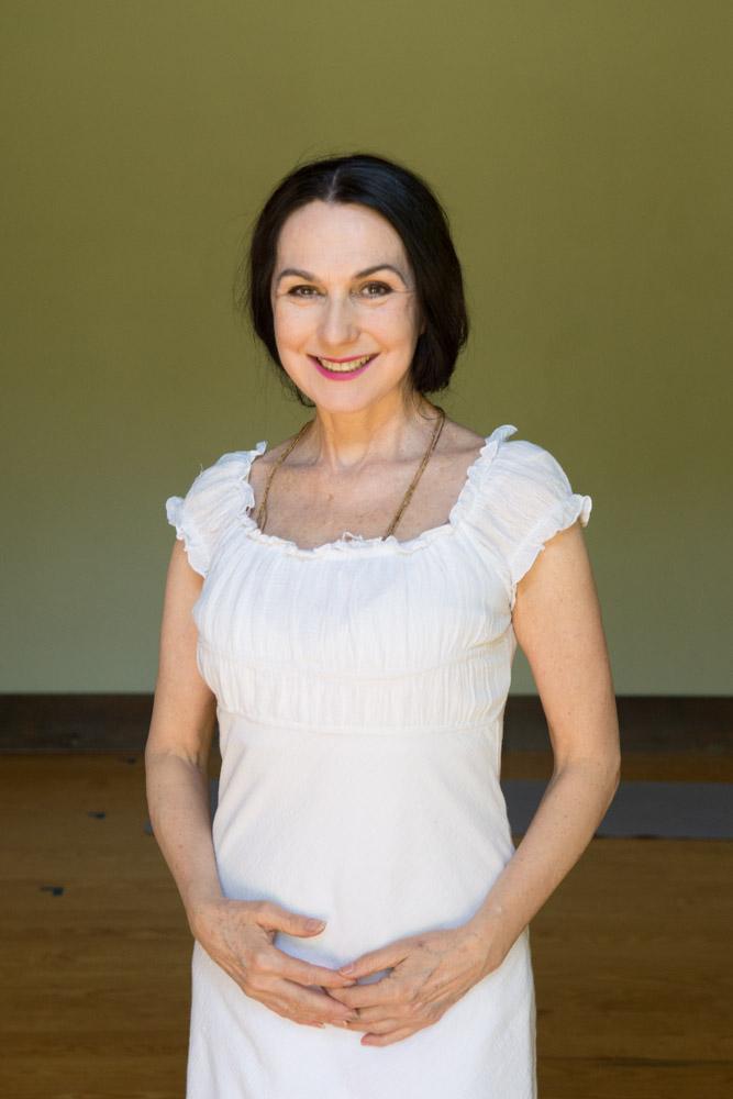 Sharon white dress studio portrait #2. Photo by Derek Pashupa Goodwin.