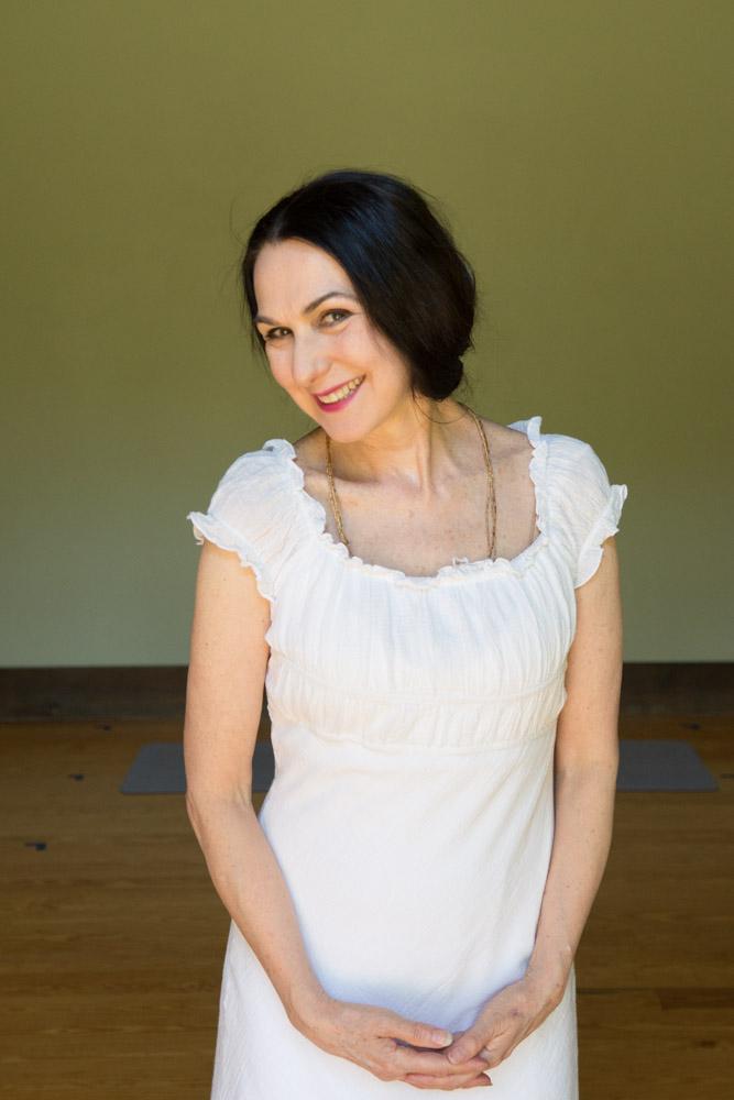 Sharon white dress studio portrait #3. Photo by Derek Pashupa Goodwin.