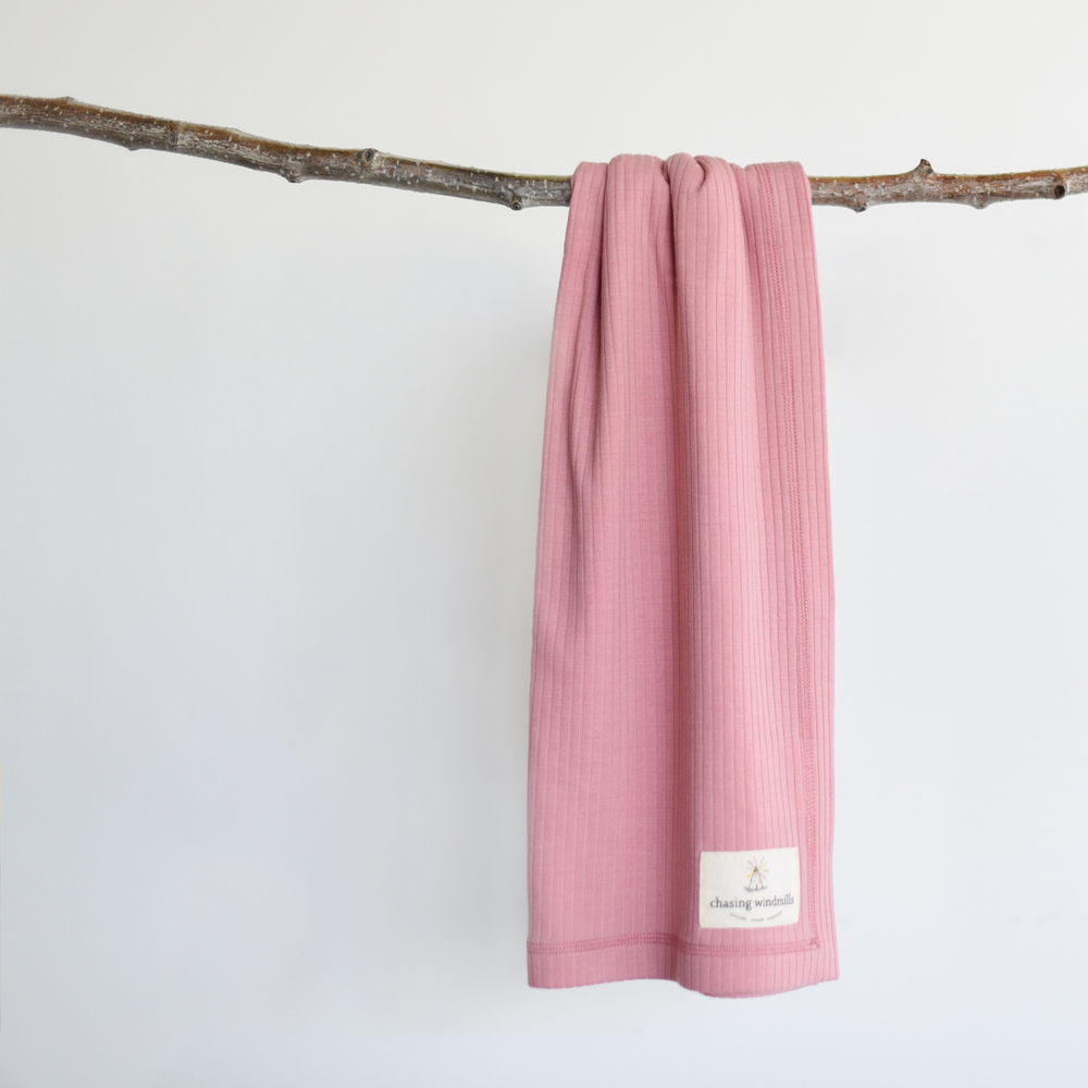 Our rose tan companion blanket, ready to travel with your little one on everyday adventures, big, small, and meaningful.