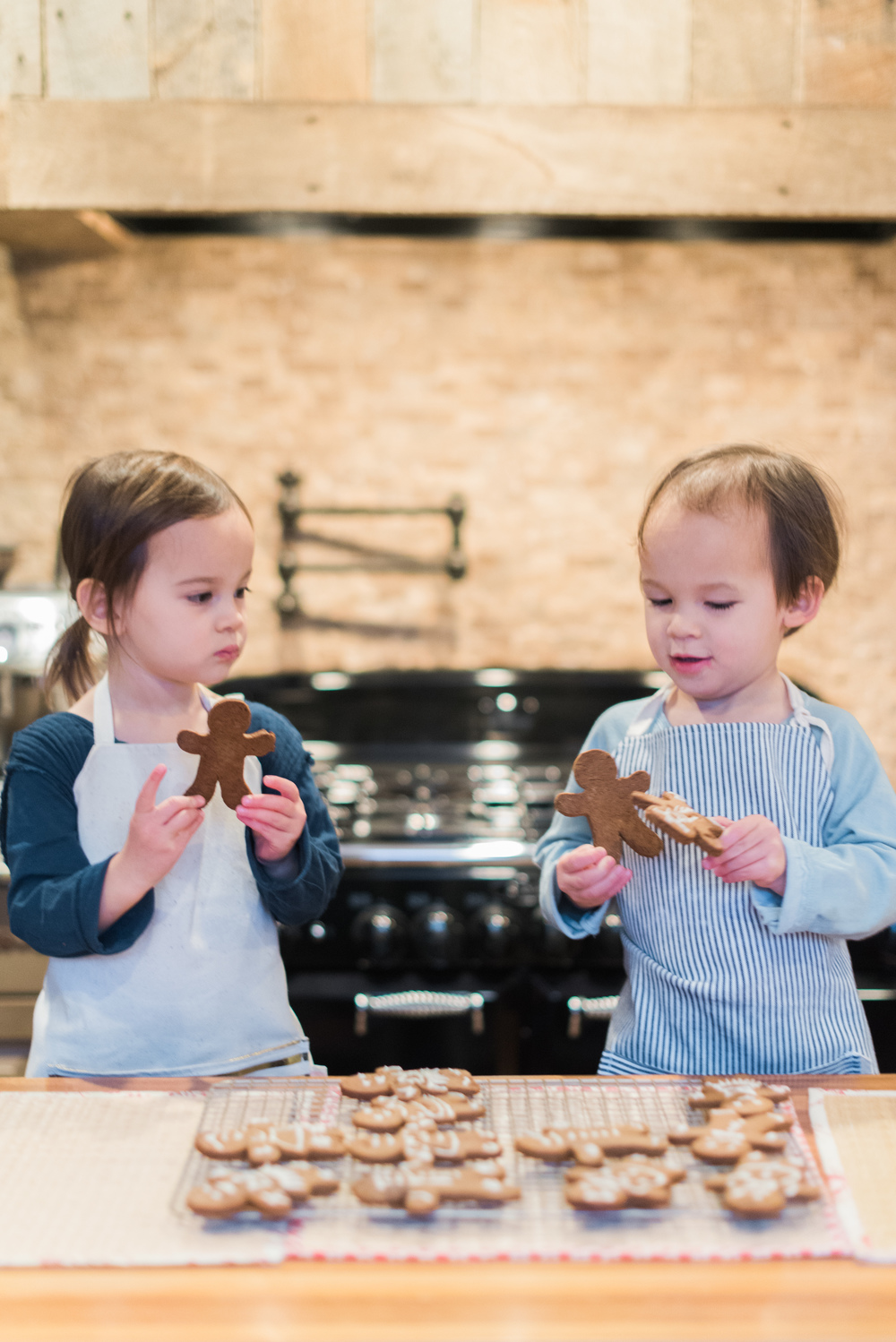 Our favorite little helpers eyeing their freshly baked gingerbread cookies!