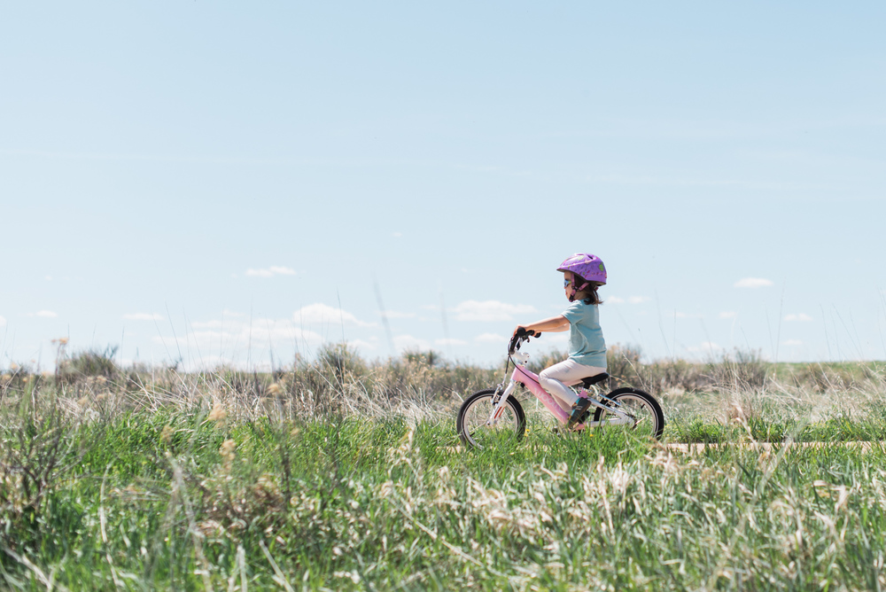 Cruising on her bike in a Follow Rivers merino tee, our little girl is ready to chase butterflies.