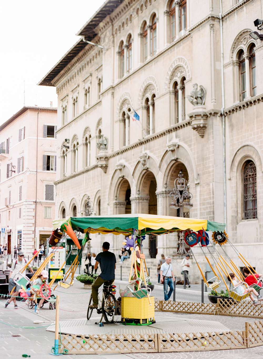 A kid's paradise: the bike merry-go-round in Perugia, Italy.  And yes, we did this...again and again and again!