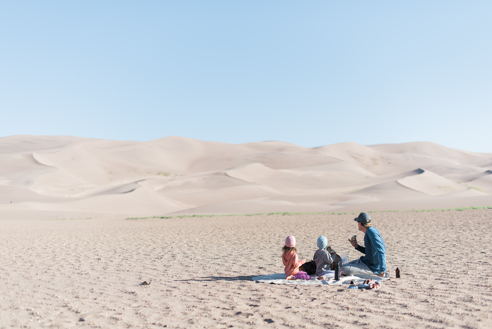 Our breakfast during a crisp cool morning at the Great Sand Dunes National Park.  // kiddos pictured wearing our  merino hoodies  and  beanies .
