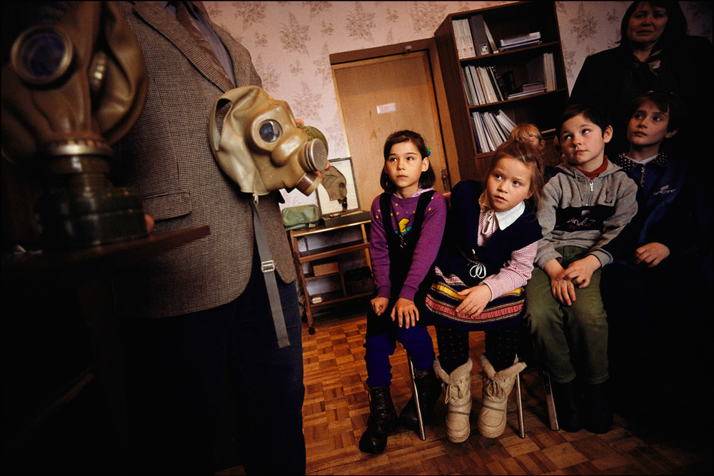 Children in Shchuch'ye Russia learn about the chemical weapons stored just outside their village. The children have only their scarves for protection in case of an accident.