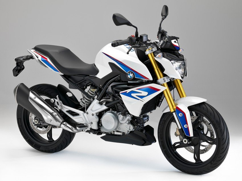 Venturing onto new ground is the G 310 R, featuring a newly developed 313 cc liquid-cooled single-cylinder engine with four valves and two overhead camshafts, together with electronic fuel injection. The capacity of 313cc results from a bore of 80 millimetres and a stroke of 62.1 millimeters, BMW said. Designed for the world market, the bikes will be produced in India by partner TVS Motor Co. They can run on the most diverse fuel qualities, and meet all emission standards and local requirements. The engine has a backward-tilted cylinder in open-deck design with the cylinder head turned by 180 degrees, making it possible to position the intake tract at the front, viewed in the direction of travel. With an output of 25 kW (34 hp) at 9 500 rpm and a maximum torque of 28 Nm at 7 500 rpm, the engine of the new G 310 R is a very dynamic partner in conjunction with the low unladen weight of 158.5 kilograms, according to the OEM. The compact proportions and the short wheelbase promise fast changes of direction, while the high rear hints at the bike's sporty genes. The small headlamp mask, dynamically modeled fuel tank trim elements and roadster proportions make for an eye-catching ride. In spite of its naked bike character, the side surfaces in body color create a closed silhouette. The bike has a rigid tubular steel frame, upside-down fork and long swinging arm for added ride stability, precise steering response and sound handling. In terms of suspension, the new G 310 R has a torsionally stiff, robust tubular steel frame in grid structure with bolt-on rear frame. The front wheel suspension is taken care of by a solid upside-down fork while at the rear there is an aluminium swinging arm in conjunction with a spring strut mounted directly. As for the ride, the new G 310 R features a markedly relaxed seating position, BMW noted. All switches and controls are simple and secure to handle, it added. The G 310 R is fitted with ABS as standard. It combines a powerful brake system with 2-channel ABS. At the front wheel, a single-disc brake with radially bolted four-piston fixed caliper and a brake disc diameter of 300mm ensures powerful and stable deceleration, the company said. At the rear, this function is performed by a 2-piston floating caliper in conjunction with a 240mm brake disc. The G 310 R instrument cluster has a large liquid crystal display that offers excellent clarity and a wide range of information, the OEM noted.
