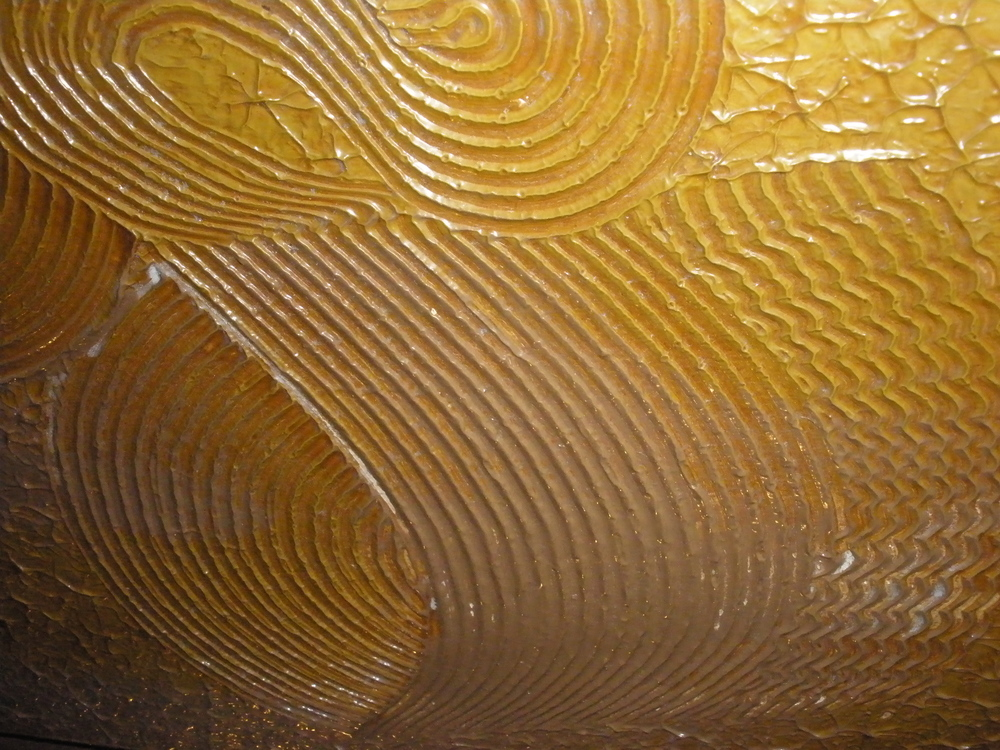Detail of wall in the Copper King Mansion, the W.A. Clark home in Butte, Montana. Plaster was painted in swirls of gold in the entryway, bronze in the octagonal reception room, silver in the dining room, and copper in the billiard room. c. Bill Dedman
