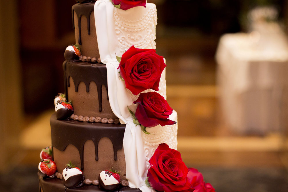 ABOVE: Accented with tuxedo strawberries and red roses, it's no wonder why the cake was Ashley's favorite wedding detail.