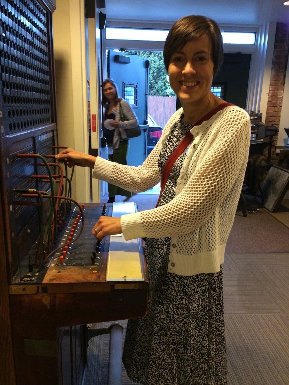 Outreach Director Christine Brown marveled at the antique switchboard.