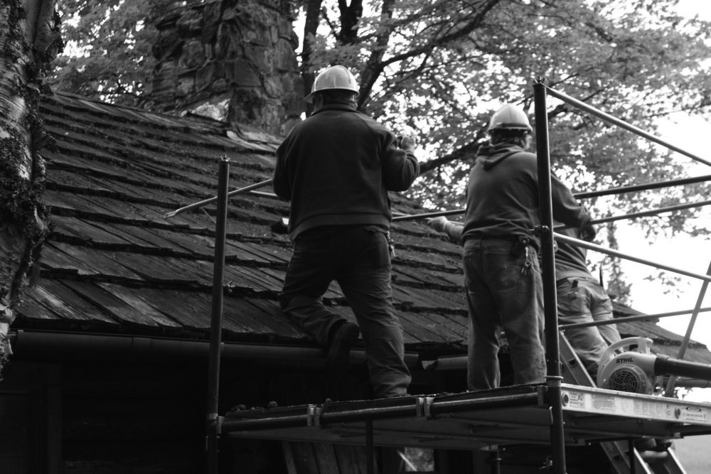 Last summer, maintenance crews carefully scraped years of moss off the shingles at the Wheeler Camp in Glacier National Park.