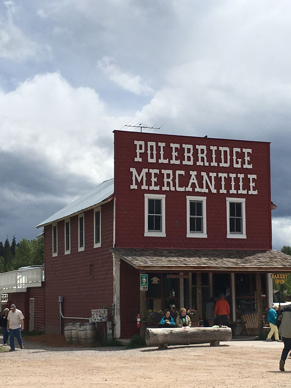 The store (now the Polebridge Mercantile) was completed in 1914. An icehouse and shop were added soon after. A barn, which burned to the ground in the Red Bench fire of 1988, was completed in the early 1920s. Known in the early days simply as Adair's, it was the social and business hub of the North Fork and a gateway to the new national park across the river. These five buildings make up the W.L. Adair General Mercantile Historic District. The District was placed on the National Register of Historic Places in 1983 as representative of an early Montana mercantile enterprise.
