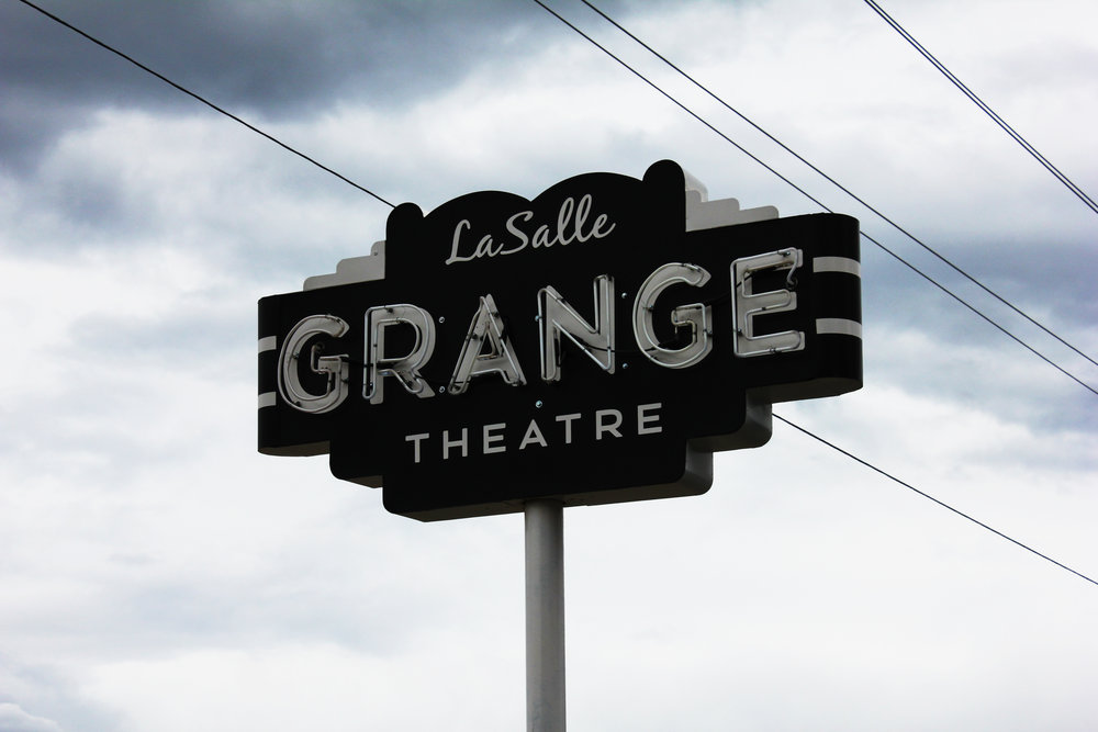The new owners have adaptively reused the grange hall as a small theater.
