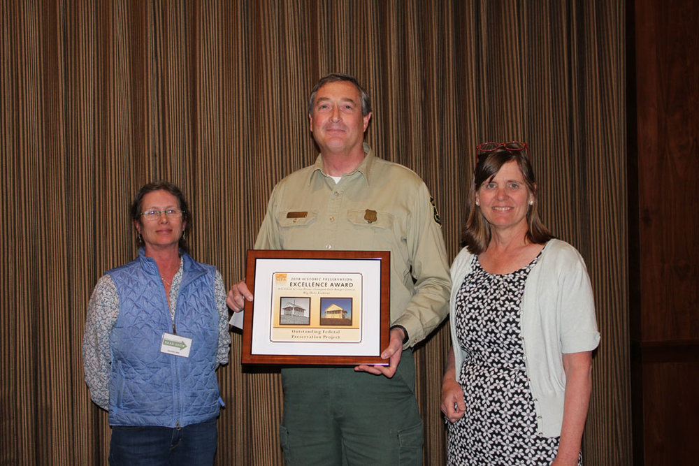 David Hattis of the Plains Thompson Falls Ranger District accepting the Outstanding Federal Preservation Project Award for  the Big Hole Restoration Project alongside Stephanie Ambrose-Tubbs and Chere Jiusto.