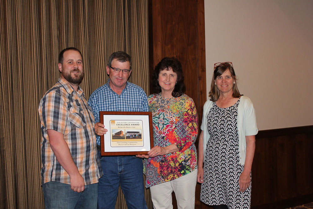 Randy and Maureen Mannix accepting the award given to the Helmville Rodeo Club for an Outstanding Community Preservation Project with Chere Jiusto (right) and MPA Restoration Director Dustin Kalanick (left).