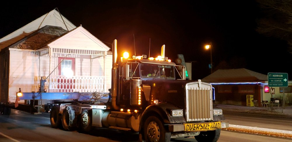 The Baxendale Schoolhouse rolling through the intersection at William Street and US Highway 12 just after midnight.