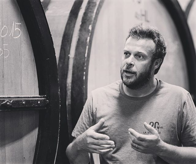 One of the best things about our work is meeting passionate people from all corners of the world (like Cedric here, winemaker and proprietor of @domainelasuffrene in Bandol, France).⠀ *****⠀ What do we all have in common? Wine. A deep, deep infatuation with making wine, drinking wine, talking about wine, and learning about wine. Are you one of us?⠀