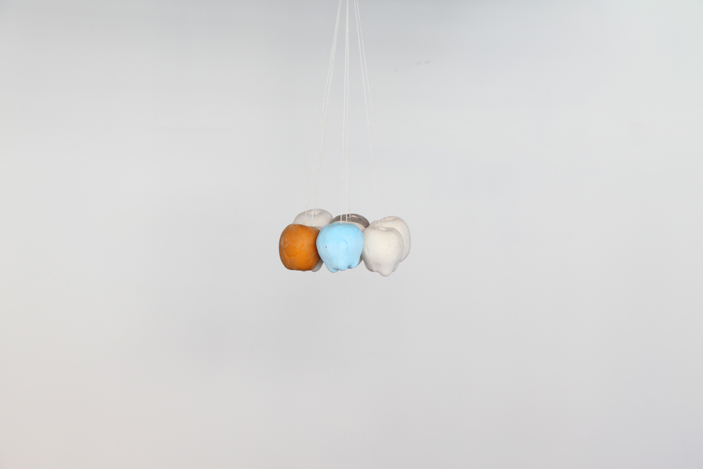 Eight Apples, 2012 plaster, pigment, rubber, string,  9 x 9 x 18 in