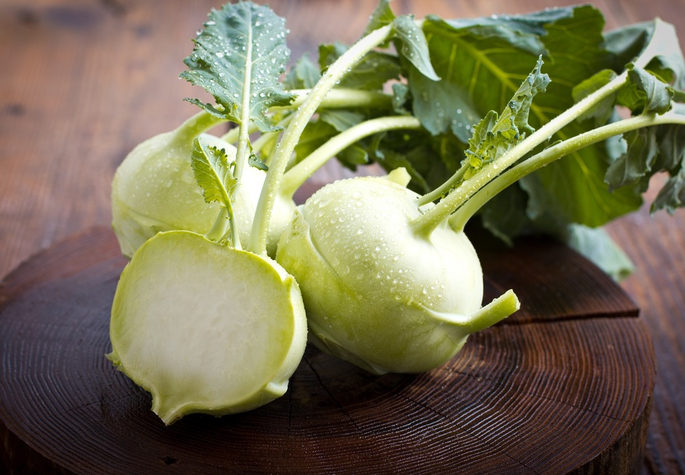 Kohlrabi - consists of a long stalk and large leaves protruding from a spherical base. This base is a root and tastes similar to radishes when raw and broccoli when cooked. Kohlrabi can be pickled or eaten raw, thinly sliced with lemon and salt. The leaves can also be eaten like spinach. Varieties include purple and pale green.
