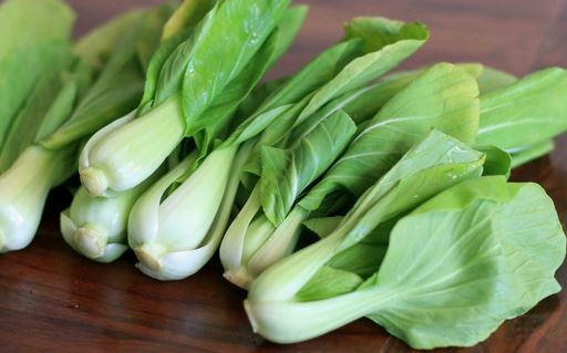 Baby Bok Choy . - This is an asian vegetable. Very hearty and nutritious.  Steam, sauté, or eat it raw sliced into salads. Treat it as you would Napa cabbage. Don't be afraid if you have never tried this before. Taste it raw and then try it cooked with garlic or add it to soups or stir-fry.