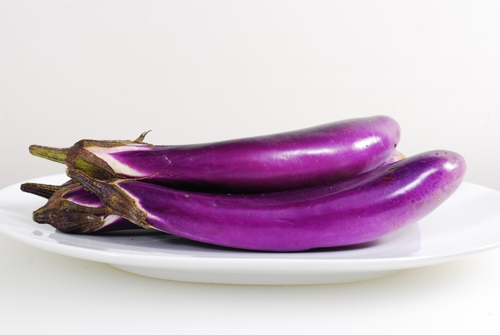 Japanese Eggplant - Similar to regular eggplant but with a fun shape. Slice it cross ways or long ways, toss with olive oil, season with salt and pepper and fry or grill it until soft. Add garlic or other seasonings for additional flavor. Note that eggplant will soak up liquids at first but when salt is added it will release its liquid.