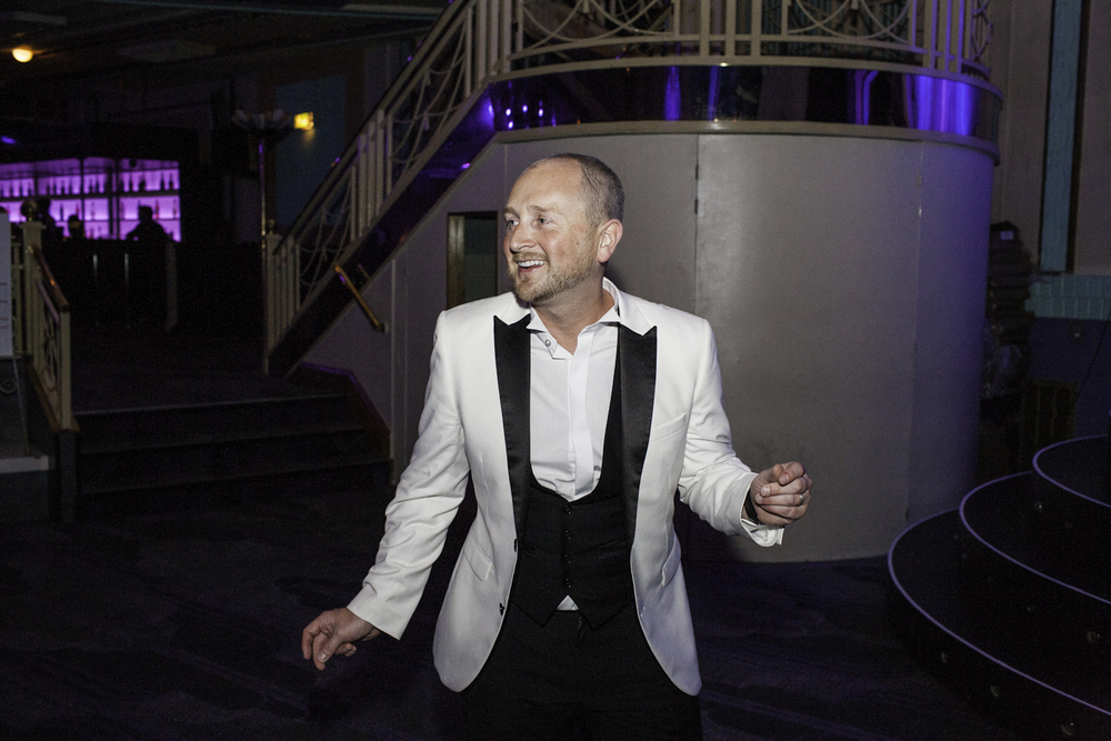 A Post Office employee enjoys himself dancing at the Troxy