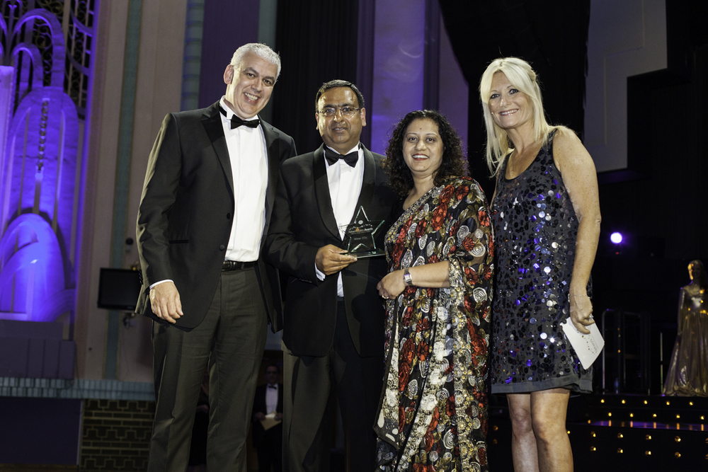 Television star Gaby Roslin presents awards to winners of the Post Office awards at the Troxy