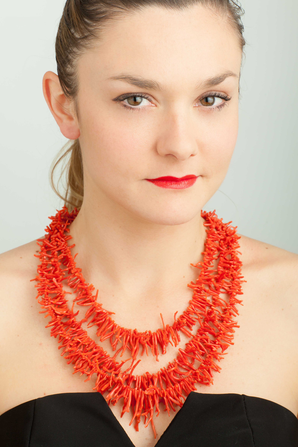 Mariagrazia is wearing one of her creations: Red Passion.