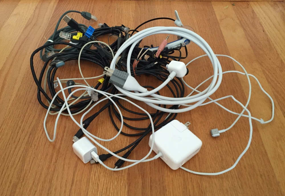 """Collection of known usable wires that keep us """"connected"""".In addition, there is a box somewhere that contains cords and wires to those electronic devices which have gone to the great beyond."""