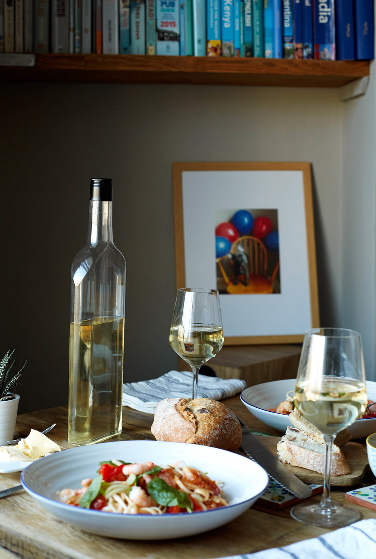white wine bottle glasses and food.jpg