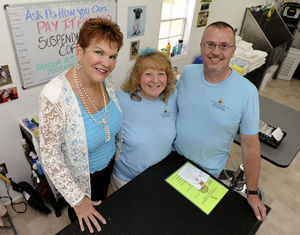 "Brennen Smith/Decatur Daily Sue Grumbir, left, Denise Tortora and Roger Lankford, of Suspended Coffee Decatur, helped start the ""pay it forward"" program. The effort involves customers going to a local business and ""suspending"" or paying for a service or product that will benefit someone else who may not be able to afford it."