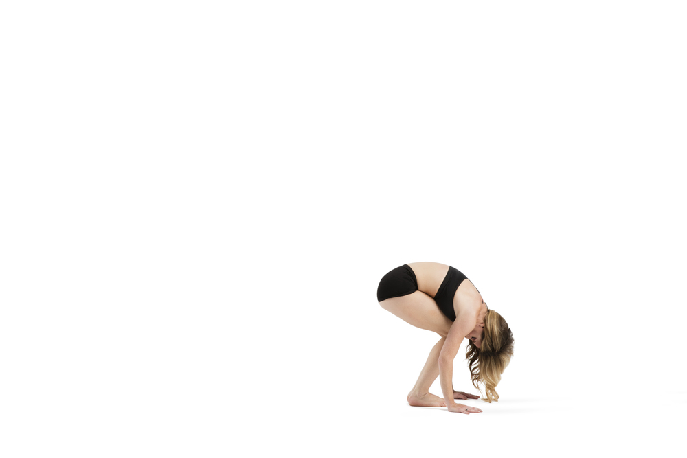 "Easy forward fold- get whimsical with it. Let the head be heavy and neck be long and loose.  Gently sway the head ""no"" and ""yes"" releasing any tension in the neck.  Soften the shoulders, round the spine and hollow out the abs.  8 breaths"