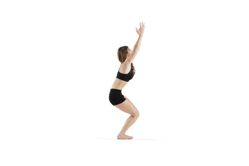 Sweep to CHAIR...deep bend the knees, gently tuck tail and deepen the abs. lift the toes up to avoid gripping or overcompensation.  Shoulders are plugged in while as lengthen to lift torso. 7 breaths