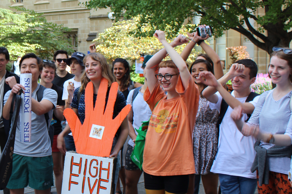 Phoebe Gavine, pictured in orange, studies Science at Melbourne Uni and is a member of FFMU's Media and Communications team.