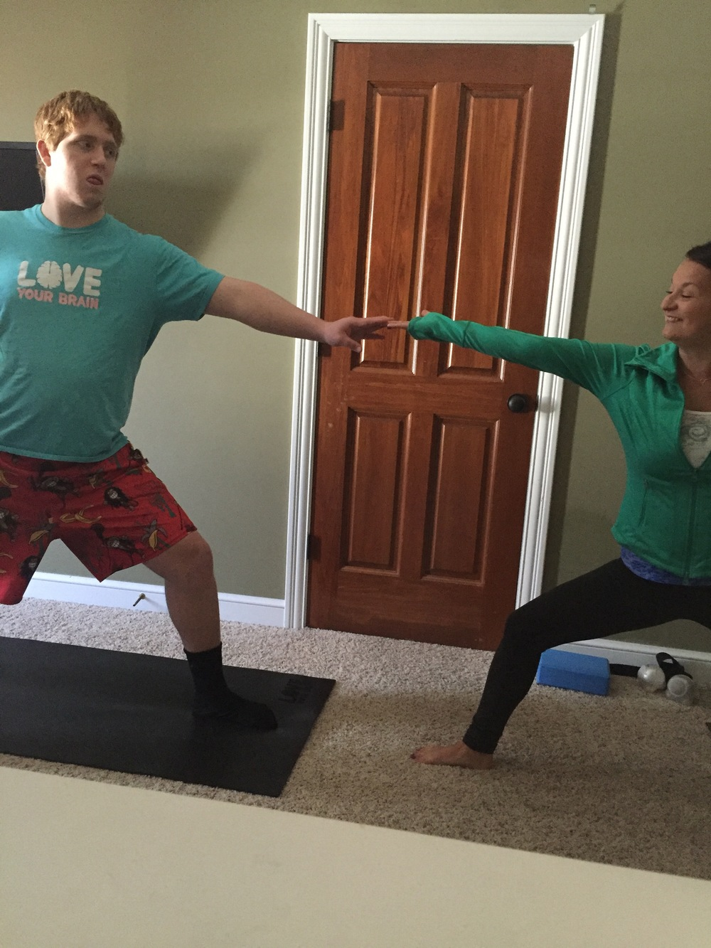 Mark working on his recovery with a yoga instructor.