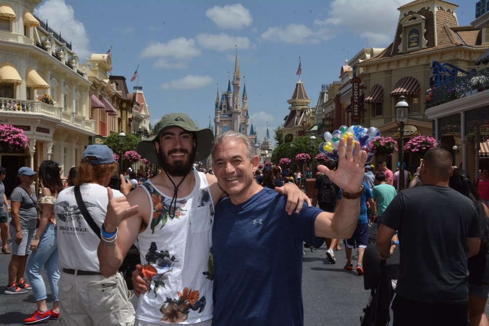 My dad and me at Disney World for our annual trip 7 months after my accident