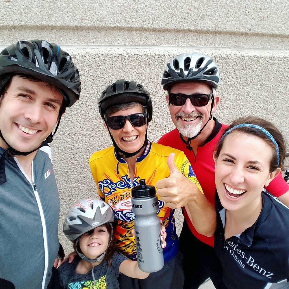 """Corp Cycle Challenge"" - I used to ride 25 miles every August in the Corporate Cycle Challenge with my family. I was not able to ride for three years. This is me with my family, including my now 7 year-old granddaughter, after completing a 10 mile ride"