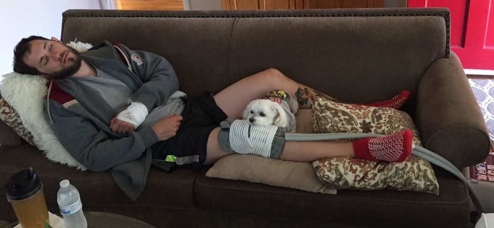 Post accident, recovering from hand and knee surgery with my dog Max.
