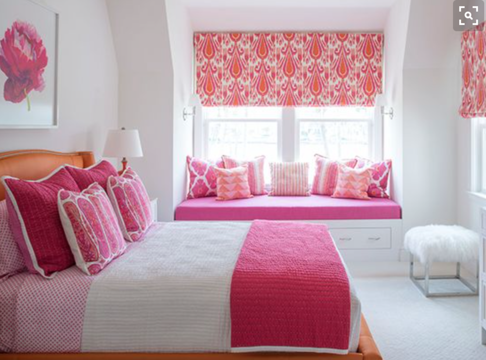Another fun pink and tangerine girl's bedroom.